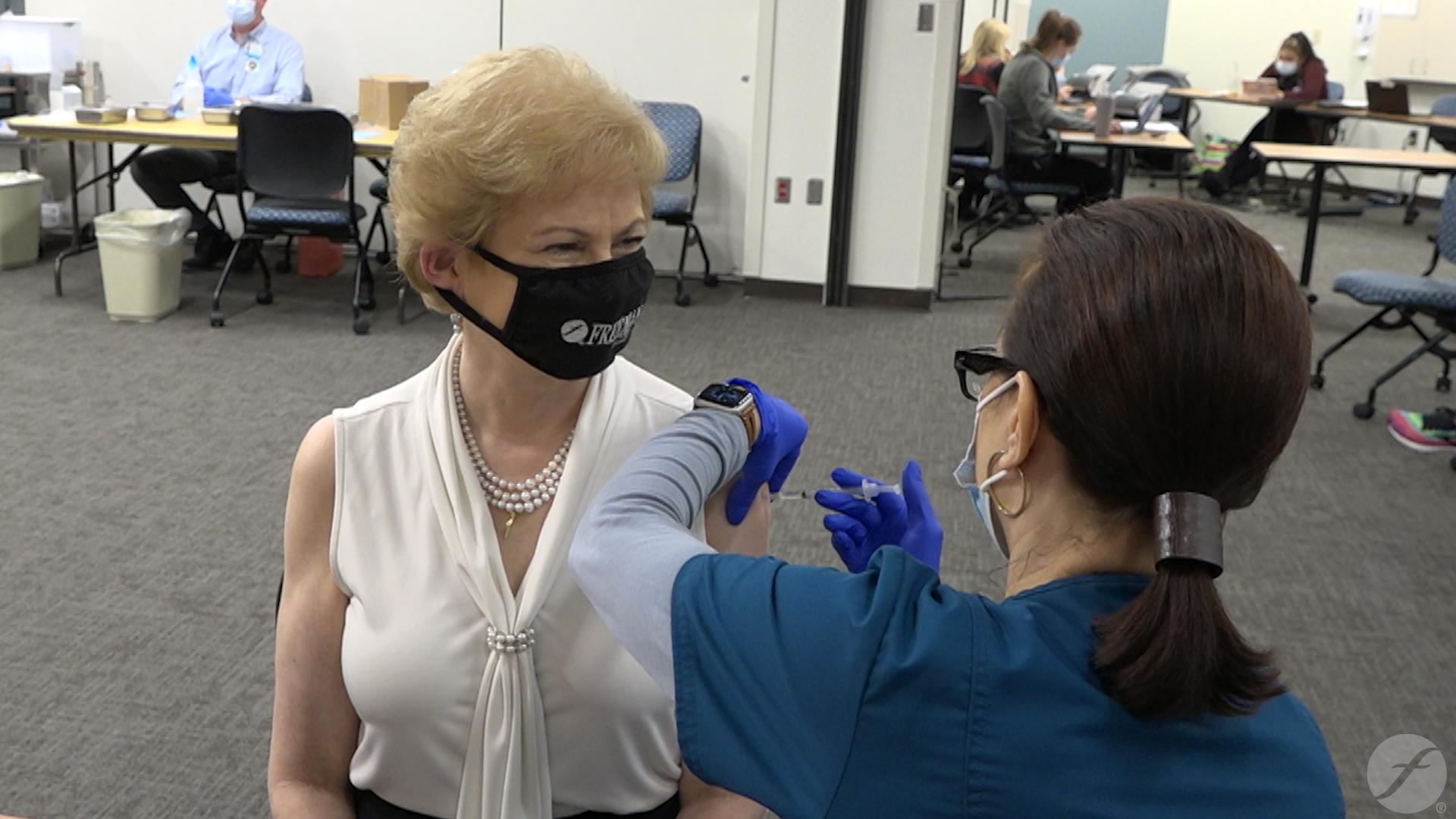 Freeman CEO Paula Baker gets vaccine
