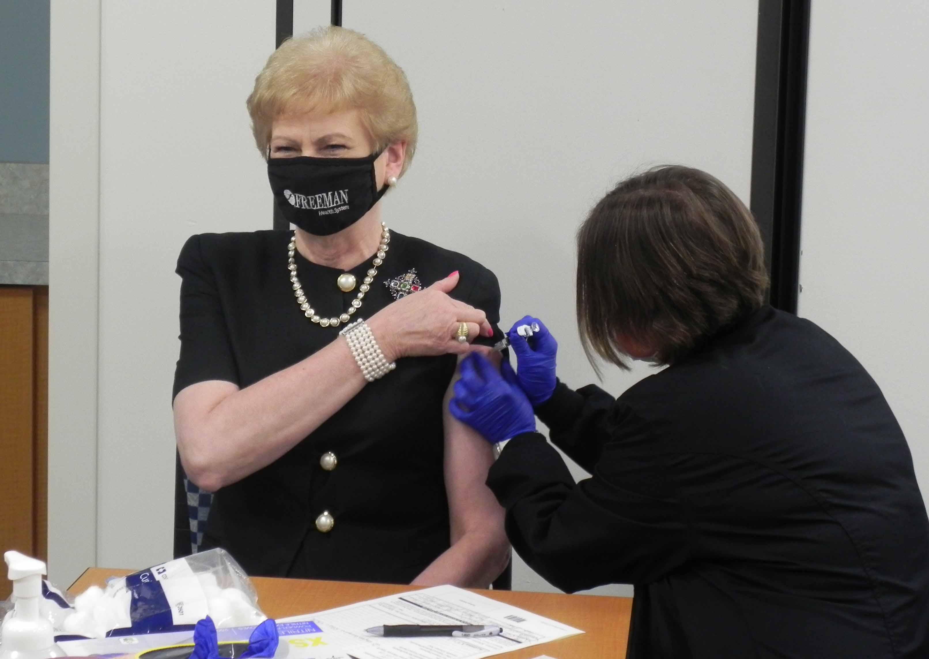 Paula Baker getting flu shot